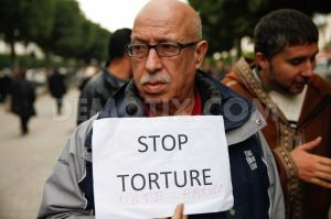 1386817877-protest-against-torture-in-tunisia-on-international-human-rights-day_3475917