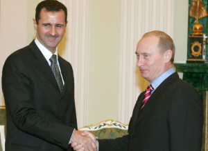 Russia's President Putin and Syrian President Bashar al-Assad  shake hands as they meet in Moscow